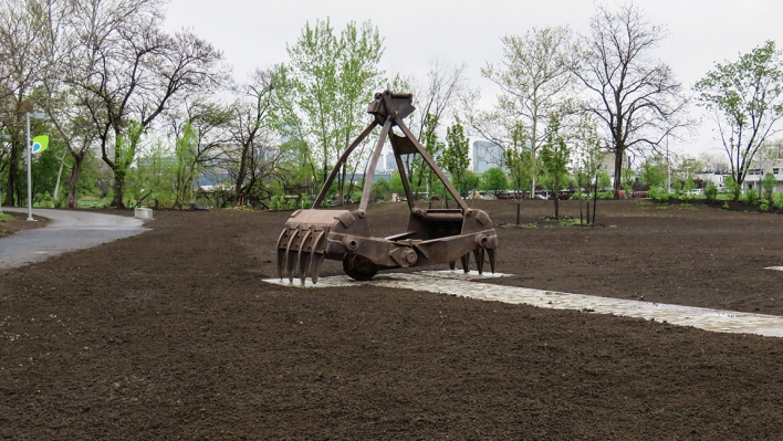A large metal clamshell installed as art in field