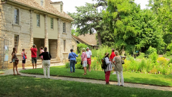 a tour group explores the historic Bartram House in Southwest Philadelphia