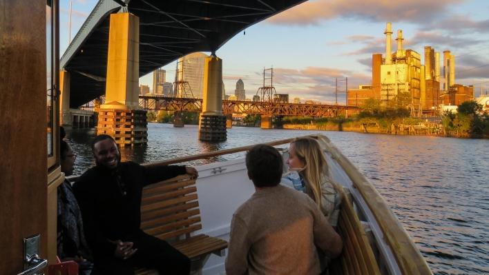 View of Philadelphia at dusk from under the 1-76 Bridge
