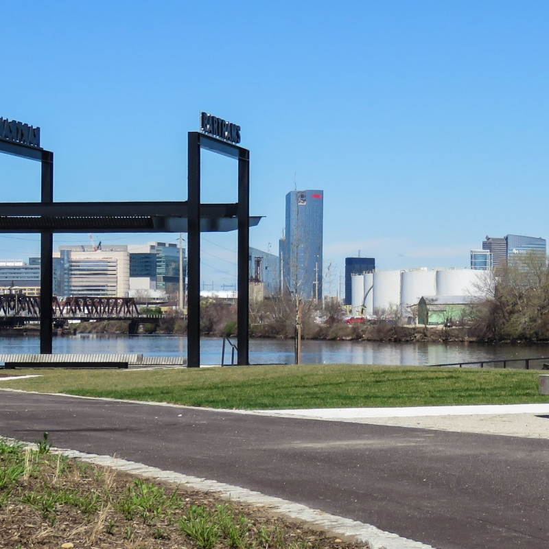 View of a new riverfront plaza with the Philadelphia skyline in the background