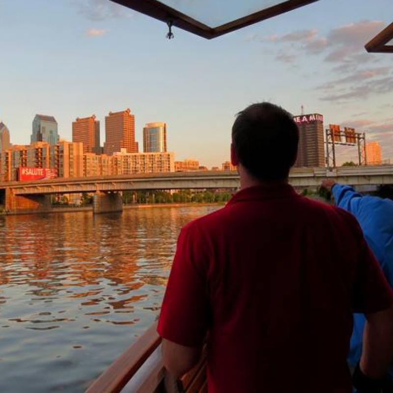 Philadelphia skyline from a boat on the Schuylkill at dusk